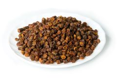 Propolis granules inside plate, bee product Stock Photo