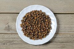 Propolis granules inside plate, bee product Royalty Free Stock Images