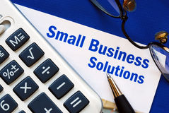 Proporcione a las soluciones financieras a la pequeña empresa Imágenes de archivo libres de regalías