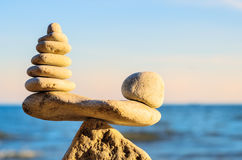 Proportion of stones. Stack of zen stones in balance at seashore stock photography