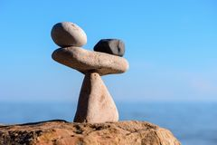 Proportional balance at coast. Balance of black and white stones at coast Stock Photography