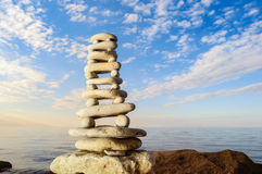 Proportional. Balancing of stones each other on the seashore Stock Photography
