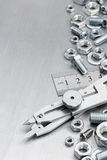 Proportional divider, ruler, screws and bolts. On metallic scratched shiny background Stock Photo
