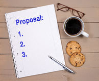Proposal Checklist with Coffee and Cookies Royalty Free Stock Images