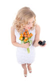 Proposal concept - surprised woman with tulips and little gift b Royalty Free Stock Image
