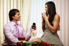Proposal of engagement. A young men giving engagement ring to his girlfriend while making her proposal Royalty Free Stock Photos