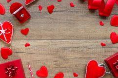 Proposal and engagement concept with romantic border arrangement felt and pillow hearts, red ring box on wooden stock photos