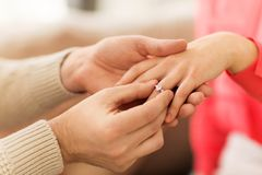 Man giving diamond ring to woman on valentines day stock photos