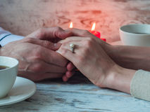 Proposal with engagement ring, can be used for St. Valentine`s day. Close up Stock Photos