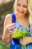 Proposal, holidays, jewelry and people concept - close up of happy woman with engagement ring in the park Royalty Free Stock Images