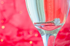 Proposal with ring in champagne glass Royalty Free Stock Photo
