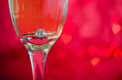 Proposal with ring in champagne glass Royalty Free Stock Image