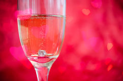 Proposal with ring in champagne glass Royalty Free Stock Images