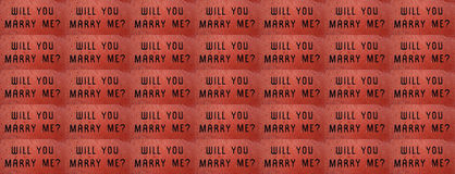 Proposal Web Banner. `Will You Marry Me?` Banner and Background, with proposal etched into tiled red brick Royalty Free Stock Images