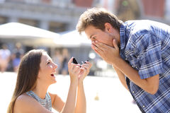 Proposal of a woman asking marry to a man stock photos