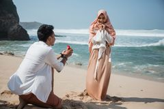 Propose the girl that he loved. Man standing on his knee trying to propose the girl that he loved stock images