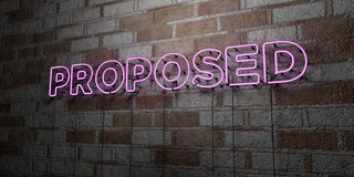 PROPOSED - Glowing Neon Sign on stonework wall - 3D rendered royalty free stock illustration Royalty Free Stock Photo
