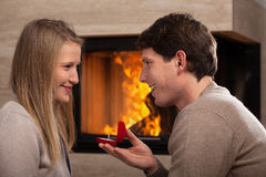 Proposing by fireplace Stock Photography