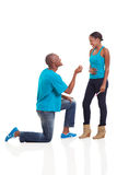 Proposing girlfriend pregnant. Happy african men down on his knee proposing to girlfriend when she is pregnant Royalty Free Stock Photos