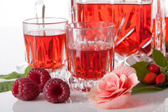 Proposition of serving raspberry liqueur Stock Photos