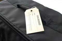 Propriété perdue lable sur le sac noir Photos stock