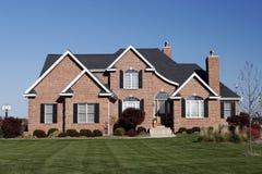 Propriétaire d'une maison immobilier de boîtier Photo stock