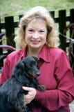 Propriétaire heureux d'animal familier Photos libres de droits