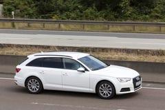 Propriedade de Audi A6 na estrada Fotografia de Stock Royalty Free