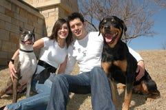 Proprietários felizes do animal de estimação Imagem de Stock Royalty Free