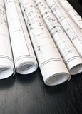 Proprietà delle cianografie dei rotoli e di piani dell'architetto Fotografie Stock Libere da Diritti
