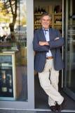 Proprietario di negozio del vino Fotografie Stock Libere da Diritti
