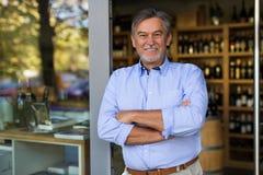 Proprietario di negozio del vino Immagine Stock