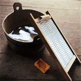 Props for old fashioned washing. Wash board, old wooden bucket of water, soap for washing clothes on wooden boards Stock Images