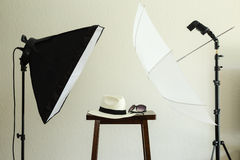 Props for a social media profile picture. Photo shoot props for a social media profile picture: hat and sunglasses. Includes a softbox, speedlight/strobe, white Stock Photo