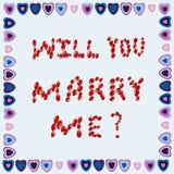 Propuesta de matrimonio en un marco de corazones en un fondo azul Foto de archivo libre de regalías