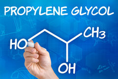Propylene glycol. Hand with pen drawing the chemical formula of Propylene glycol Royalty Free Stock Photos