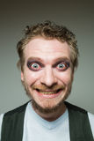 Prortret smiling bearded man with makeup. Royalty Free Stock Image