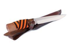 Prorusse lehnt sich Messer auf einem Weiß auf Stockfoto