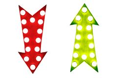 Pros and cons: red down and green up vintage retro arrows illuminated with light bulbs. Royalty Free Stock Photo