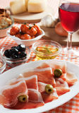 Prosciuto served as appetizer Royalty Free Stock Photo