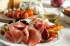 Prosciuto served as appetizer. Prosciutto and olives served as antipasto, traditional italian appetizer Stock Image