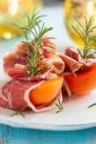 Prosciutto with apricots Stock Photos