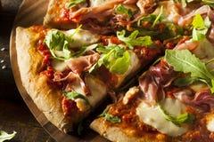 Prosciutto and Arugula Pizza Stock Photography