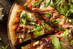 Prosciutto and Arugula Pizza. With Marinara Sauce stock photo