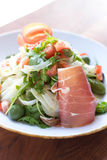 Prosciutto and Arugula Salad. Fresh salad topped with prosciutto, fennel, and tomatoes Stock Images