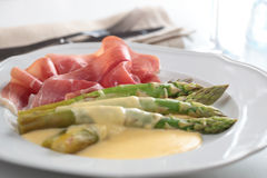 Prosciutto with asparagus Royalty Free Stock Photography