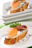 Prosciutto and blue cheese canapes Royalty Free Stock Photo