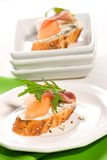 Prosciutto and blue cheese canapes stock photography