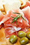 Prosciutto with bread and olive Stock Image