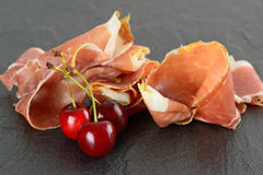 Prosciutto and cherries Royalty Free Stock Photography